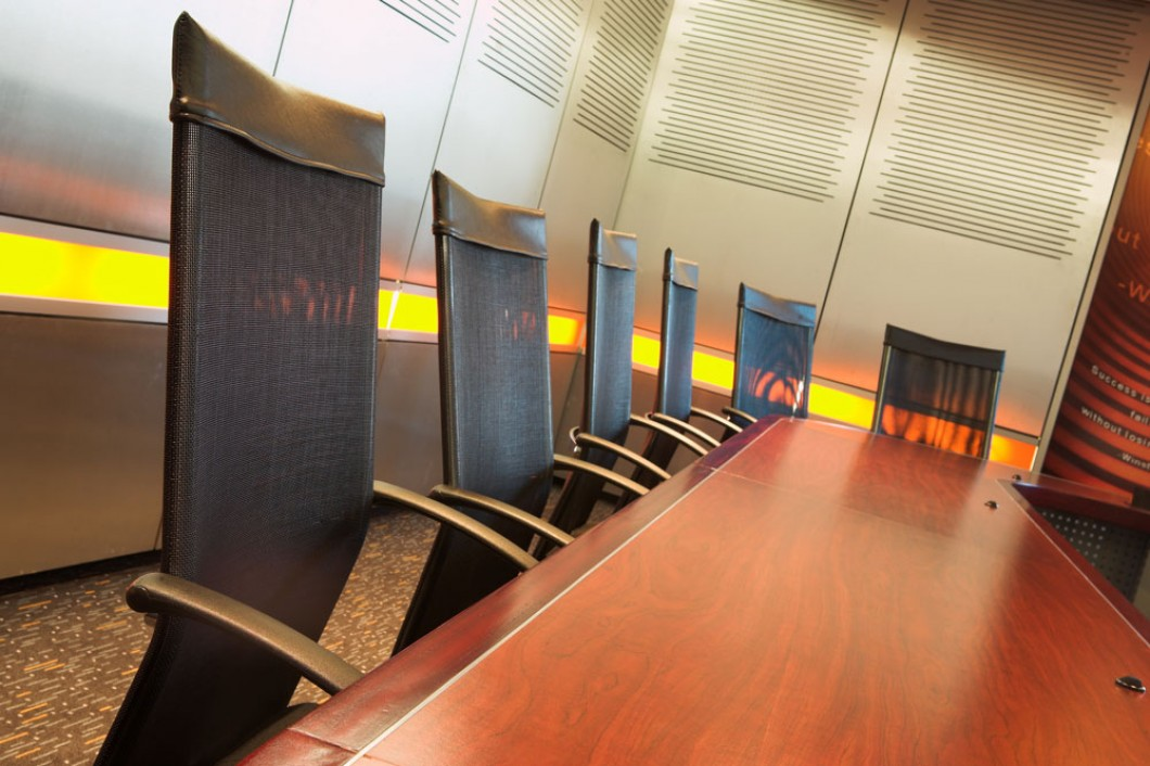 six office chairs around a conference table