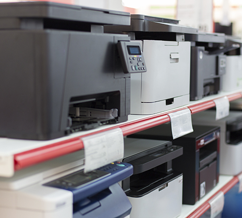 two shelves of printers and scanners